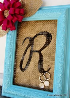 Burlap frame earring holder. I went to Goodwill and bought cheap frames (all under $4) spray painted them, bought the burlap for about $3/yard and they turned out great! So cute.