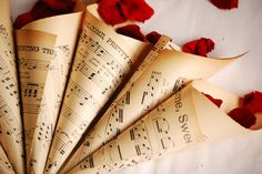 Make cones from sheet music for each guest with rose leafs as confetti for a wedding