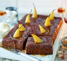 A lighter version of sticky toffee pudding, rich with dates and spices, and the juicy texture of poached pears, this vegan dessert is sure to please a crowd