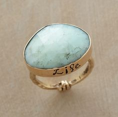 "AMOR VITA RING -- Jes MaHarry's freeform faceted chrysoprase underscores the liberating message she inscribes on its 14kt gold bezel, ""Love life."" 18kt gold band. Exclusive"