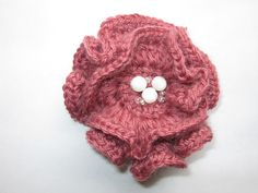 Pink crocheted brooch with glass beads in the center. $13.00