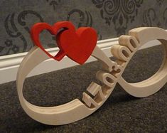 Infinity Sign with date + heart of wood – Inkesworld Infinity Sign with date + heart of wood Unendlichkeitszeichen mit DatumHerzen aus Holz Wood Projects, Woodworking Projects, Wood Crafts, Diy And Crafts, Wood Carving Patterns, Diy Wood Signs, Scroll Saw Patterns, Wooden Hearts, Painting On Wood