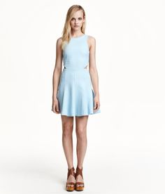 Icy blue textured dress with flared skirt, V-neck back, and side cut-outs. | H&M Pastels