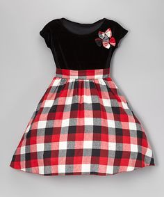 A flannel plaid adds a cozy touch to a flouncy cotton dress finished with coordinating bows on the bodice.