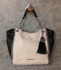 Michael Kors chain handle purse with tassel. Clothes Mentor