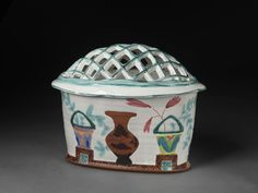 Flower brick and cover | Ostrom, Walter | V Search the Collections