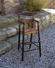 Hitchcock-style child's maple rush seat high chair. Original black paint with original stencil in muted shades of salmon, olive, and gold. New England, c. 1840.