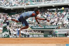 FRANCE, Paris : France's Gael Monfils dives in a try to return to Czech Republic's Tomas Berdych during their French Tennis Open first round match at the Roland Garros stadium in Paris, on May 27, 2013. AFP PHOTO / THOMAS COEX