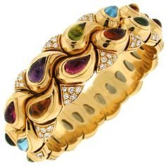 CHOPARD - Colorful and chic bangle created by Chopard. It is made of yellow gold and set with round diamonds, tear-drop shape amethyst, peridot, citrine, aquamarine and pink tourmaline. 21.5k USD