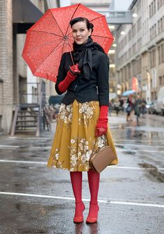 Red tights, mustard floral scarf & a black jacket.