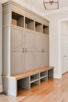 Custom Built-in lockers in mud room - Warn Stone, Sherwin Williams - Farinelli Construction