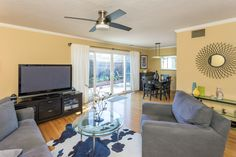 The open dining room and living room are bright and friendly. On warmer days, open wide the sliding glass doors and invite the fresh spring breeze in.