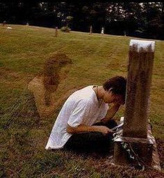 A visitor in a cemetery took a photo, and when she had the film developed, this apparition showed up on the picture - no one else was in the cemetery at the time she was there and took the picture.