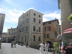 The hilltop village of Gordes in the Provence-Alpes-Côte d'Azur region of south-eastern France. The building in the middle of the picture is a real estate office (Rosier).