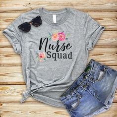 Nurse Squad Shirt| Nurse Shirt| Nursing Gift| Funny Nurse Shirt| Nursing Student| Nursing Graduate| Nurses week gift| RN shirt| LPN| This beautiful shirt features the text Nurse Squad, with a unique distressed font for the word squad complete with water color styled floral accents.