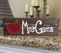 It takes a BIG heart to help shape little minds. This is my second most popular customizable item! This is a fantastic teacher gift! The letters are hand painted with a cute lil string art Apple!