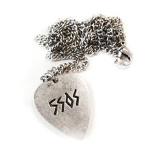 Exclusive Limited Edition Plectrum Necklace, designed by Luke. The necklace features 5SOS etched on one side with X etched on the reverse. Plectrum on 29 inch c