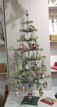 A true vintage German Feather tree with 100 year old molded ornaments! Talk about some ball hanging space - love a feather tree Primitive Christmas Decorating, Antique Christmas Ornaments, Victorian Christmas, Vintage Ornaments, Glass Ornaments, Christmas Past, Retro Christmas, Christmas Holidays, Christmas Crafts
