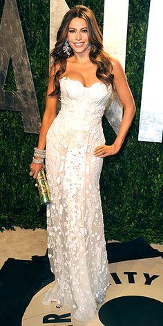 Showing off her bombshell curves in a delicate white appliquéd gown, Sofia Vergara has a white night at the Vanity Fair party in West Hollywood. 20 Dresses You Didn't See at the Oscars: http://bit.ly/Az8PKu