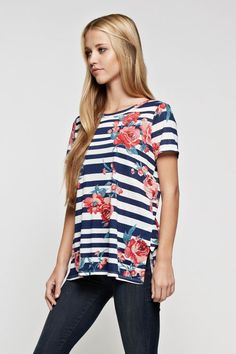 Navy and ivory stripe short sleeve top with pink flowers. $29 shipped, S-M-L Purchase here: https://www.facebook.com/photo.php?fbid=10155078493963686&set=pcb.1388574511201821&type=3&theater
