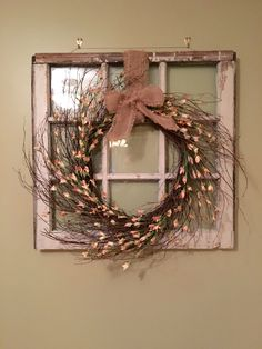 Window Sash Removed From An Old House With Homemade Wreath