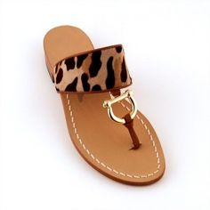 I love the equestrian detail on this sandal ~ Canfora