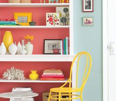 For maximum pop, try arranging the shelves with solid-colored items, like white ironwork or a vibrant vase.