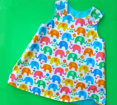 """This fully reversible dress pattern for baby gets a perfect """"A"""" for style and fit! Easy and quick to sew with plenty of room for appliques and embroidery. You'll reach for it all year round to make as a sundress in the warmer months and in denim or corduroy to pair with a top and …"""