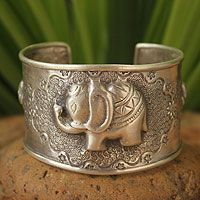 Holding her trunk high, a silver elephant shows off her two babies, all depicted in dazzling detail. Elephants hold a revered place in Thai society and appear in many proverbs and sayings. March 13 is designated as Thai Elephant Day. Jewelry Gifts, Jewelery, Unique Jewelry, Jewelry Design, Elephant Day, Thai Elephant, Elephant Ring, Elephant Bracelet, Sterling Silver Cuff Bracelet