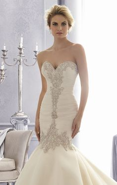 Be stunning and gorgeous in Bridal by Mori Lee 2682. This exceptional wedding gown features a strapless sweetheart neckline. This piece is adorned with beaded embroidery and a mid-back design flatters your delicate silhouette. A flared mermaid skirt leads to a train completes this charming look.