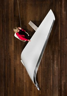 Sharp and sleek, the glossy white surface of this futuristic desk design is crafted from a reclaimed Boeing airplane wing. French design firm Les Ateliers FLOWN created the Cantilevers desk using a section of wing from a full-scale 737-800 aircraft, measuring about thirteen feet across. The desi ...