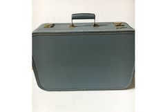 Check out this item in my Etsy shop https://www.etsy.com/listing/508359256/vintage-suitcase-lady-baltimore-1950s