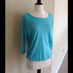 August Moon Top Wore twice but already shows wear (see 4th photo). Priced low for that reason. Polyester & viscose. Size medium but would fit small too. August Moon Tops