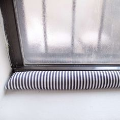 The window by the desk in our bedroom has always been noticeably drafty. I've been meaning to make a draft stopper for one of our windows a...