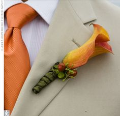 Men will wear a light tan suit with a blue and orange tie