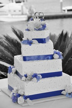 Square Wedding Cake with cobalt blue ribbon: