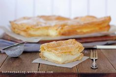 This is Karpatka. Karpatka is like a polish version of vanilla slice, or millefeuille, only instead of the puff pastry, you have layers of choux pastry. Imagine one, big, rectangular profiterole fi…
