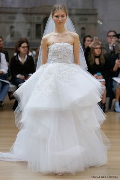 strapless straight across neckline heavily embellished bodice layered skirt ball gown wedding dress chapel train -- Oscar de la Renta Spring 2018 Wedding Dresses