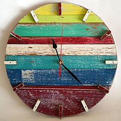 This retro beach house wall clock is handcrafted with recycled wood from old wooden boats and homes. Featuring bright colors and a weathered finish, this clock hangs beautifully on any wall. Reclaimed Wood Projects, Recycled Wood, Retro Beach House, Pallet Clock, Framed Art Sets, Florida Design, Cool Clocks, Diy Clock, Wooden Clock