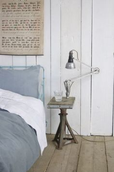 blue, grey, white and sandy. love the bed frame and rustic walls