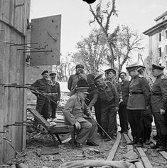 Churchill sitting in a damaged chair taken out from Hitler's bunker in Berlin Germany 16 July 1945.