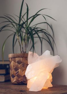 100% Unique, epic quartz cluster lamp, made with very large quartz clusters and points. Includes bulb and cord with on/off switch to plug into any outlet (110v) for easy use. Perfect night light or reading lamp for nightstand or any table.