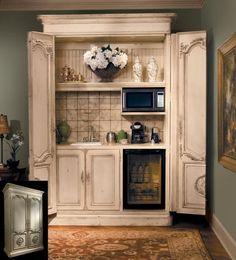 Turn an armoire into a coffee bar, drink station, snack stash....for the bedroom or guest quarters:) Kind of diggin' this idea!