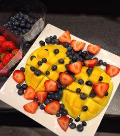 Mango love w/ blueberries and strawberries