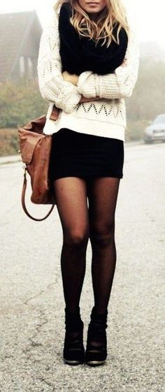 Stay warm and cute at night by pairing a white knit sweater with your black skirt. For extra warmth, add on a black chunky scarf and some black sheer tights!