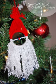 Homemade Christmas Ornaments for Kids {Easy Santa Claus Ornament} Kids love this easy Santa Claus Christmas craft! OneCreativeMommy.com