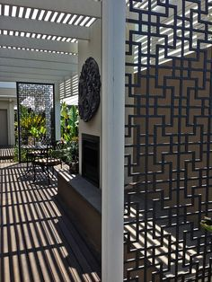 Patio screen partitions for an absolutely gorgeous deck (with a fireplace!) made from compressed hardwood in our 'Tokyo' designs. Such luxury! #decorativescreens #patio #beautifulhomes