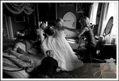 Bride putting on her shoes at Maunsel House in Somerset