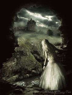 Fantasy picture of a blond girl in a white full-length dress, looking through a gap in a stone wall at a field and a stone castle building beneath a cloudy sky.