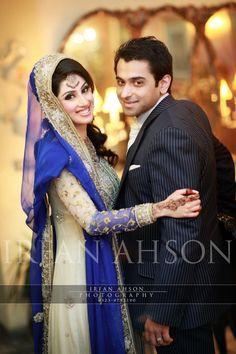 http://weddingstoryz.blogspot.in/ Indian Weddings Desi Weddings Bride makeup jewelry lehenga blue groom tuxedo colors